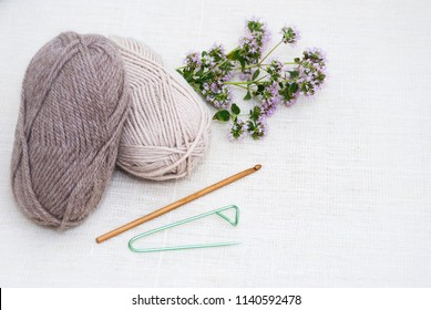 Knitting wool yarn and knitting needles on white background