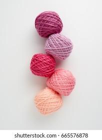 Knitting yarn balls in pink tone. Skeins of wool yarn for knitting.