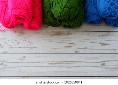 Knitting is yarn being manipulated to create a textile or fabric. Color thread.
