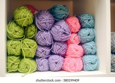 Knitting yarn on shelf, closeup photo
