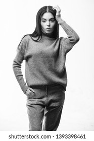 Knitwear concept. Feel warm and comfortable. Woman wear grey textile suit blouse and pants. Warm comfortable clothes. Casual style fashion for every day. Female knitwear. Fashionable knitwear.