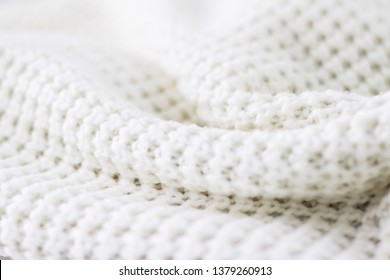 Knitwear, fabric textures and handmade items concept - Warm knitted clothes, soft and white