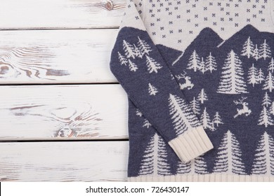 Knitwear sweater with reindeer pattern. Christmas gift idea. Thing that gives comfort and warmth.