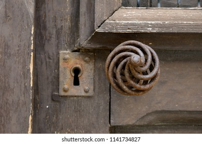 A knob and the lock of the old time wooden door