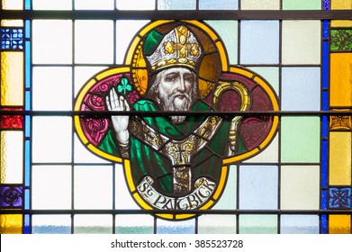KNOCK, IRELAND - CIRCA FEBRUARY 2016 - St Patrick, an Irish patron saint. A detail of a stained glass window in Knock, ireland
