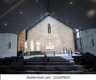 Knock, Ireland - October 13, 2018. Worshipers pray at the Knock Shrine.  The shrine is a Irish National Shrine where the faithful state that the Blessed Mother, St. Joseph and St. John the Evan