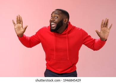 Knock who there. Charming happy funny black bearded guy bending towards camera raised palms move like mime act pressed face glass smiling joyfully fool around playful energized mood - Shutterstock ID 1946845429