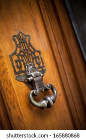 Knocker on the wooden door of a French mansion