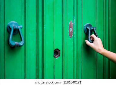 Knocking on the green door, close up