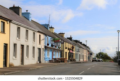 Knocknagree, County Cork, Ireland.  September 9, 2019.  A row of colourful terraced houses, including three pubs, in the centre of the village.