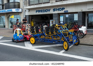 KNOKKE-HEIS, BELGIUM - JULY  11, 2016: Rental toy bicycle for children parked in street of scenery town near the beach, Knokke, Belgium