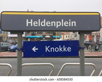 KNOKKE-HEIST , BELGIUM - DECEMBER 15, 2016 : City sign Heldenplein and arrow sign to Konkke at tram station in winter time