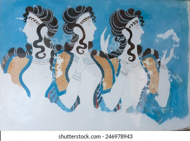 Knossos, Greece - May 12th, 2007 : Antique Minoan fresco representing three women profiles, Knossos, Greece