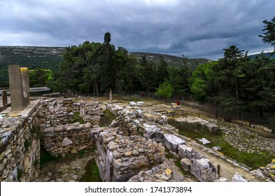 Knossos Palace, Crete / Greece - March 14, 2019: View at the archaeological site of Knossos in Heraklion city at sunset. Cloudy sky