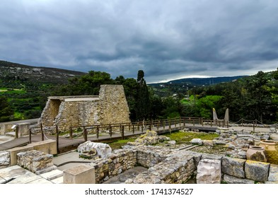 Knossos Palace, Crete / Greece - March 14, 2019: Panoramic view of the archaeological site of Knossos. The sacred Bull Horns sculpture (symbol of power for the Minoans) in the background. Sunset time