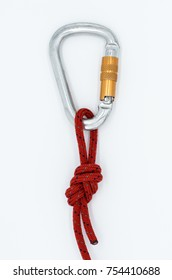 "Knot ""a double figure eight"" with carbine on the white background; Red touristic or alpinistic rope with marine knot and carbine."