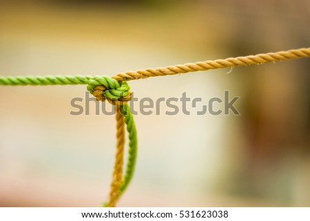 A knot , two colors are together , like two different people in relationship