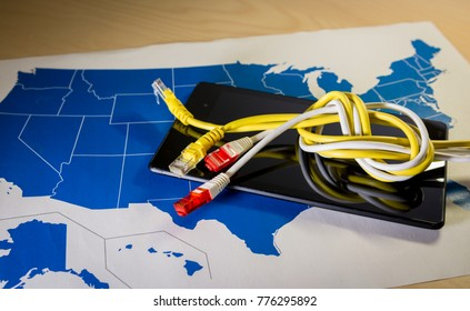 knotted net cable over a smartphone and US map. Suitable for concepts as net neutrality regulations in the USA, Internet Freedom Preservation Act and Open Internet order.
