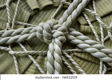 Knotted rope on a sake barrel close up in Jpan