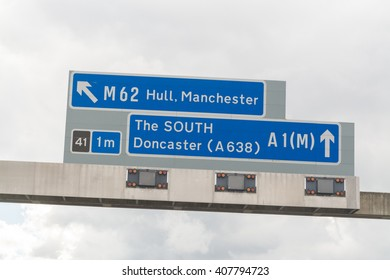 KNOTTINGLEY, YORKSHIRE, ENGLAND, UK - 16 APRIL 2016: uk motorway sign pointing south where the A1 and M62 meet