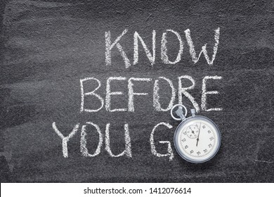 know before you go phrase written on chalkboard with vintage precise stopwatch