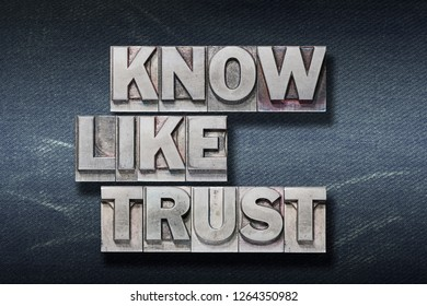 know, like, trust words made from metallic letterpress on dark jeans background