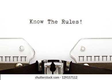 Know The Rules printed on an old typewriter.