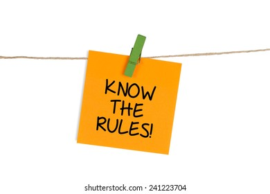 """""""Know The Rules"""" written on Sticky Note"""