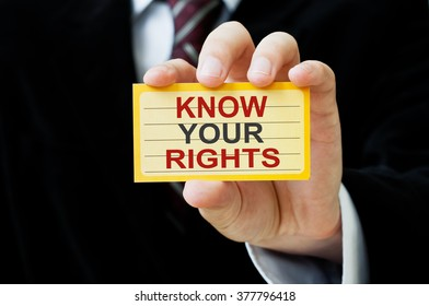 Know Your Rights. Man holding a card with a message text written on it