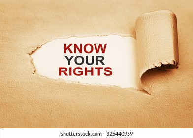 Know Your Rights Message text written behind a torn paper