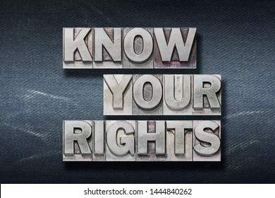 know your rights phrase made from metallic letterpress on dark jeans background