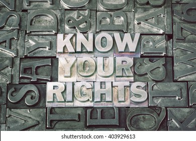 know your rights phrase made from metallic letterpress blocks with dark letters background