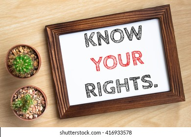 know your rights, text message on wood frame board on wood table / business concept / Top view