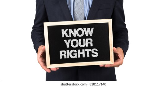 Know Your Rights written on a Chalkboard in Businessman Hands
