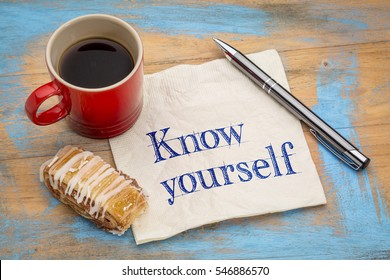 Know yourself concept - handwriting on a napkin with a cup of espresso coffee and pastry