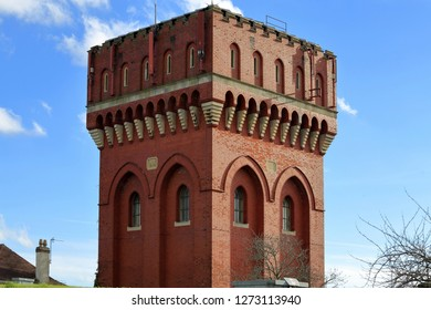 Knowle,Bristol,England,UK.11.14.2018. Water Tower with gothic arches at the top of Talbot Hill: built by Bristol Waterworks in 1905 of red brick and stone in gothic style.