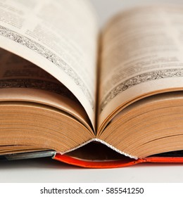 Knowledge concept: big old book with many pages open in the middle on white background