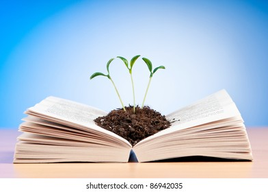 Knowledge concept with books and seedlings
