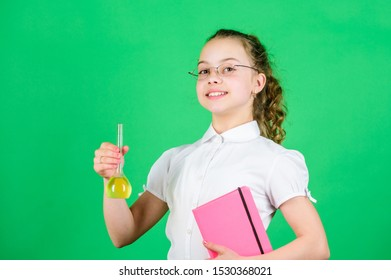 Knowledge day. Schoolgirl with colorful chemical liquids. Education concept. Safety measures. Small kid study. Chemistry lesson. Having fun with chemistry. Educative experiment. Chemistry fun.
