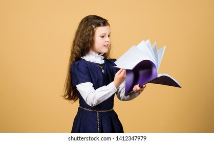 knowledge and education. Back to school. serious small girl wants to be teacher. notebook for diary notes. study lesson. small girl with paper folder. Reading is my hobby. small girl reading book.