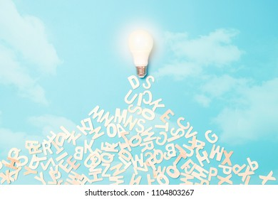 knowledge and idea concept, light bulb flying on sky and releasing letter for wisdom