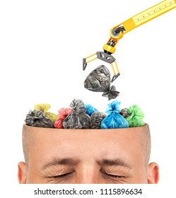 Сoncept of knowledge. The Manipulator resets the garbage bags in to the cut of the head  on a white background. Unnecessary information.