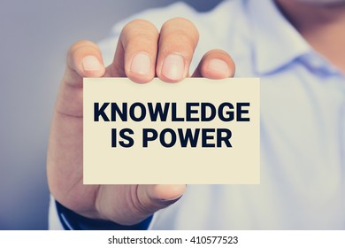KNOWLEDGE IS POWER message on the card shown by a man