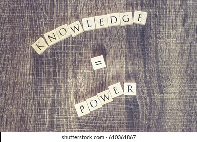 Knowledge is power quote written with wooden blocks