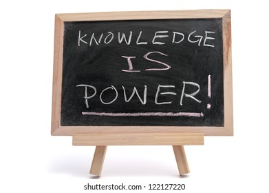 """""""Knowledge is power"""" text written on blackboard over white background"""