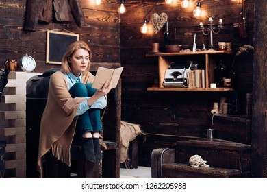 Knowledge and reading comprehension are keys to literacy. Student get knowledge from book. Pretty woman read a book. Woman student enjoy reading literacy. When getting a new book.
