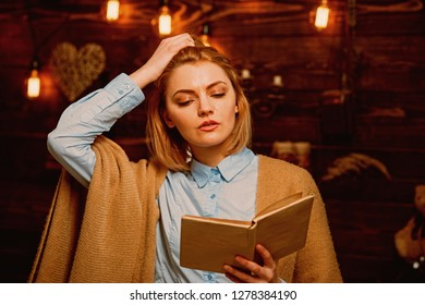 Knowledge and reading comprehension are keys to literacy. Student get knowledge from book. Pretty woman read a book. Woman student enjoy reading literacy. Knowledge is power.