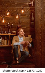 Knowledge and reading comprehension are keys to literacy. Pretty woman read a book. Woman student enjoy reading literacy. Student get knowledge from book. Preparing to exams.