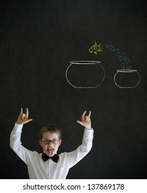 Knowledge rocks boy dressed up as business man with chalk fish jumping from small bowl to big bowl on blackboard background