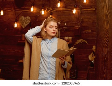 Knowledge is the way to the success. Pretty woman read a book. Woman student enjoy reading literacy. Knowledge and reading comprehension are keys to literacy. Student get knowledge from book.